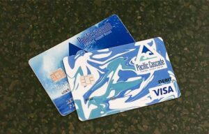 A PCFCU credit card and debit card