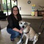 PCFCU Employee and her dog Samson
